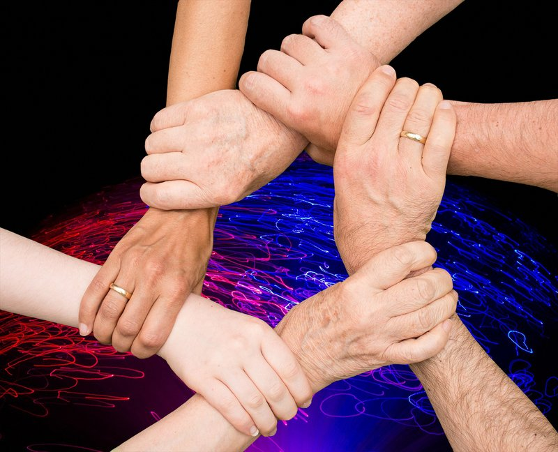 hands holding wrists overlay light represents neural pathway activity