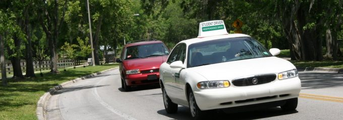 student driver car on road curve